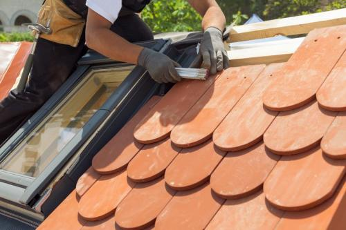 Natural roof tile instaalation. Roof with mansard windows.